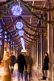 ITALY, Venice. Christmas decorations hangs along the crowded Procuratie Nuove in St. Mark's Square.