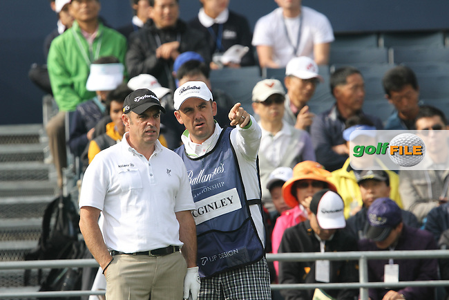 Paul McGinley (IRL) with his caddy for the tournament Simon Hurd on the 1st on Day 3 of the Ballantines Championship 2012 at Blackstone Golf Course, Icheon, Korea...(Photo Jenny Matthews/www.golffile.ie)