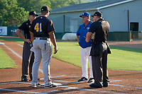 Bluefield Blue Jays manager Dennis Holmberg (35) talks with Bristol Pirates manager Miguel Perez (41) and umpires Adam Clark and Zachary Robbins before a game against the Bristol Pirates on July 26, 2018 at Bowen Field in Bluefield, Virginia.  Bristol defeated Bluefield 7-6.  (Mike Janes/Four Seam Images)