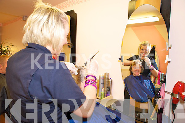 Hair stylist Valerie Lyne looks after a client at the Killarney Beauty Salon on High Street.