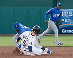 Reno Aces Cole Gillespie is tagged out attempting to steal by Las Vegas 51s second baseman Ruben Gotay during their game played on Thursday night, May 3, 2012 in Reno, Nevada.