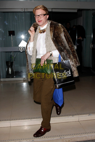 Henry Conway.Rodial Beautiful Awards, Sanderson Hotel, London, England..March 6th, 2012.full length white shirt brown fur jacket cape glasses gold necklace trousers green clutch bag goody .CAP/AH.©Adam Houghton/Capital Pictures.
