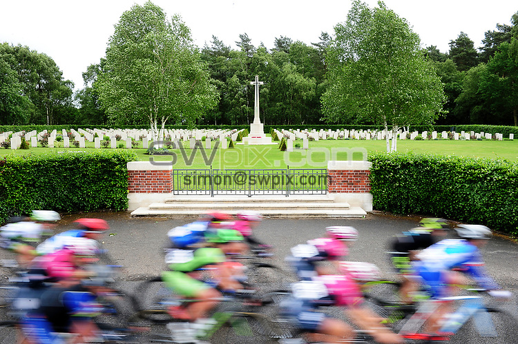 Picture by Simon Wilkinson/SWpix.com 08/06/2017 - Cycling OVO Energy Women's Tour 2017 - Stage 2 - Stoke-on-Trent - The peloton races past the Cannock Chase War cemetary.