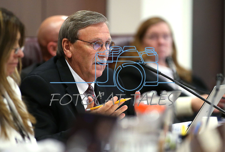 Nevada Assemblyman John Ellison, R-Elko, works in committee at the Legislative Building in Carson City, Nev., on Monday, May 4, 2015.<br /> Photo by Cathleen Allison
