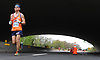 Marathoners run beneath the Sunrise Highway underpass as they proceed north on Wantagh Parkway during the Long Island Marathon on Sunday, May 6, 2018<br />