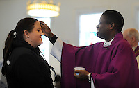 DOYLESTOWN, PA - FEBRUARY 18: Father Paschal Onunwa (R) gives ashes on parishioners foreheads for Ash Wednesday at Our Lady of Mt. Carmel Catholic Church February 18, 2015 in Doylestown, Pennsylvania. (Photo by William Thomas Cain/Cain Images)