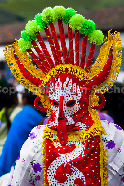 "A man dancer in a colorful costume performs Aya Uma, the creature from the Indian myths, during the Inti Raymi celebration in Pichincha province, Ecuador, 27 June 2010. Inti Raymi, ""Festival of the Sun"" in Quechua language, is an ancient spiritual ceremony held in the Indian regions of the Andes, mainly in Ecuador and Peru. The lively celebration, set by the winter solstice, goes on for various days. The highland Indians, wearing beautiful costumes, dance, drink and sing with no rest. Colorful processions in honor of the God Inti (Sun) pass through the mountain villages giving thanks for the harvest and expressing their deep relation to the Mother Earth (Pachamama)."