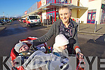 Christmas shopping in Castleisland on Thursday was Shiela O'Connor from Scartaglin with her children Kelvin and Kirsten.