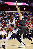 Washington, DC - MAR 11, 2018: Rhode Island Rams forward Cyril Langevine (10) in action against Davidson Wildcats forward Will Magarity (22) during the Atlantic 10 men's basketball championship between Davidson and Rhode Island at the Capital One Arena in Washington, DC. (Photo by Phil Peters/Media Images International)