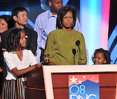 Denver, CO - August 25, 2008 -- Malia Ann Obama, left, eldest daughter of United States Senator Barak Obama (Democrat of Illinois), hits the gavel as her mother, Michelle Obama, center, and youngest sister, Sasha, right, look on during a walk-through prior to the opening of Day 1 of the 2008 Democratic National Convention at the Pepsi Center in Denver, Colorado on Monday, August 25, 2008..Credit: Ron Sachs - CNP.(RESTRICTION: NO New York or New Jersey Newspapers or newspapers within a 75 mile radius of New York City)