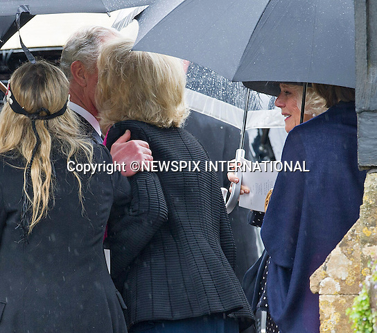 PRINCE CHARLES EMBRACES CAMILLA SISTER ANNABEL ELLIOT WHILE SHE LOOKS ON<br /> They were attending the funeral of Mark Shand, Camilla's brother who died in New York last week.<br /> Others attending the funeral included sister Annabel and family as well as his daughetr Ayesha.<br /> Also present were Andrew Parker-Bowles, Camilla former husband and Annabel Goldsmith<br /> The funeral service was held at the  Holy Trinity Church, Stourpaine in Dorset_01/05/2014<br /> Mandatory Credit Photo: &copy;Francis Dias/NEWSPIX INTERNATIONAL<br /> <br /> **ALL FEES PAYABLE TO: &quot;NEWSPIX INTERNATIONAL&quot;**<br /> <br /> IMMEDIATE CONFIRMATION OF USAGE REQUIRED:<br /> Newspix International, 31 Chinnery Hill, Bishop's Stortford, ENGLAND CM23 3PS<br /> Tel:+441279 324672  ; Fax: +441279656877<br /> Mobile:  07775681153<br /> e-mail: info@newspixinternational.co.uk