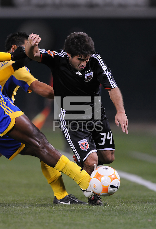 DC United forward Franco Niell (34) gets tackled. DC United defeated Harbour View 5-0 (6-1 on aggregate) in the second leg of the CONCACAF Champions' Cup quarterfinal series at RFK Stadium in Washington D. C. on March 18, 2008.