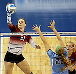 SIOUX FALLS, SD - DECEMBER 8:  Kassy Johannsen #21 from the University of South Carolina Aiken tries to get a kill past the defense of Ally Rohn #22 from Palm Beach Atlantic during their quarterfinal match of the NCAA DII Volleyball Championships at the Sanford Pentagon in Sioux Falls, SD. (Photo by Dave Eggen/Inertia)