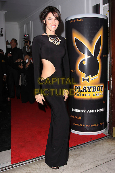 KELLY BROOK.Attending the Playboy Energy Drink UK Launch Party at Funky Buddha, London, England, UK, November 18th 2010..full length  black long maxi  cut out side dress sleeve .CAP/AH.©Adam Houghton/Capital Pictures.