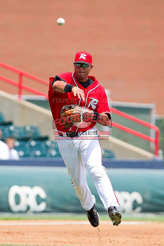Third baseman Chris Dominguez #37 of the Richmond Flying Squirrels makes a throw to first base against the Harrisburg Senators at The Diamond on July 22, 2011 in Richmond, Virginia.  The Squirrels defeated the Senators 5-1.   (Brian Westerholt / Four Seam Images)