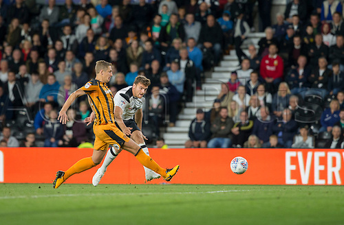 8th September 2017, Pride Park Stadium, Derby, England; EFL Championship football, Derby County versus Hull City; Chris Martin of Derby County takes a shot at the Hull City goal as Michael Dawson of Hull City stretches to block the ball