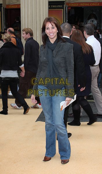 ANDREA McLEAN.10th Anniversary Performance of 'The Lion King' at the Lyceum Theatre, London, England..October 18th 2009.full length jeans denim black jacket shoulder pads scarf .CAP/ROS.©Steve Ross/Capital Pictures.