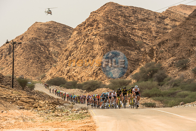 The peloton lined out during Stage 6 of the 10th Tour of Oman 2019, running 135.5km from Al Mouj Muscat to Matrah Corniche, Oman. 21st February 2019.<br /> Picture: ASO/Kåre Dehlie Thorstad | Cyclefile<br /> All photos usage must carry mandatory copyright credit (© Cyclefile | ASO/Kåre Dehlie Thorstad)