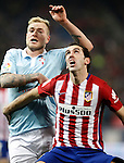 Atletico de Madrid's Diego Godin (r) and Celta de Vigo's John Guidetti during Spanish Kings Cup match. January 27,2016. (ALTERPHOTOS/Acero)