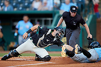 Ocelotes de Greensboro catcher Grant Koch (34) applies a tag to Miguel Aparicio (5) of the Hickory Crawdads as he slides head first into home plate whle home plate umpire Jennifer Pawol looks onat First National Bank Field on June 11, 2019 in Greensboro, North Carolina. The Crawdads defeated the Ocelotes 2-1. (Brian Westerholt/Four Seam Images)