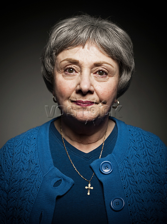 Studio portrait of senior woman