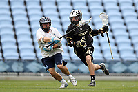 CHAPEL HILL, NC - MARCH 10: Logan McGovern #1 of Bryant University is defended by Cam Macri #28 of the University of North Carolina during a game between Bryant and North Carolina at Dorrance Field on March 10, 2020 in Chapel Hill, North Carolina.