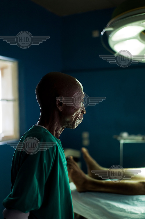 One of the surgical team at the Hospital du Bon Berger in Kananga, with a patient prior to their operation.