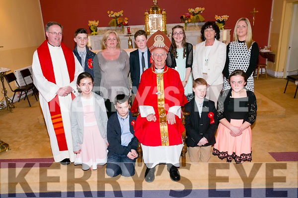 The 6th class students of Clogher NS, Ballymacelligott  who were Confirmed in St Brendans Church, Clogher on Thursday April 14th 2016. By Bishop Ray Browne. Pictured Front l-r  Caoimhe McCarthy, Darren Breen, Jean Brosnan and Ellie Lenihan. Back l-r PP  Fr Pat Crean-Lynch, Adam Kelly, Mrs Lennane, Denis Brosnan, Rachel O'Connor, Miss Twomey and Sinead Murphy, Principal