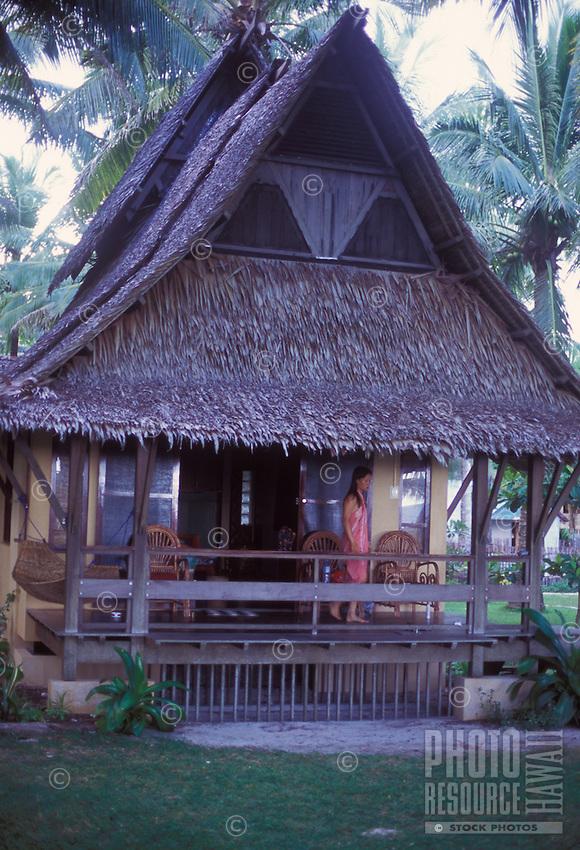 Woman on veranda of traditional Filipino home in Sagana Resort on Siargao Island