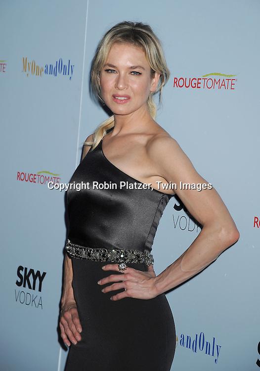 actress Renee Zellweger in Caroline Herrera gray dress