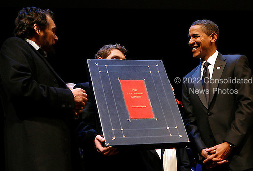 Washington, DC - February 11, 2009 -- United States President Barack Obama receives a replica of the Gettysburg Address, a gift from Ford's Theater, from an actor dressed as Abraham Lincoln during the Ford's Theater reopening celebration, Washington, DC, Wednesday, February 11, 2009. Abraham Lincoln was shot at the Theater in the evening of April 14, 1865. The theater underwent an 18 month renovation..Credit: Aude Guerrucci - Pool via CNP