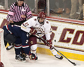 Kevin Keenan, Derek Pratt (UConn - 2), Destry Straight (BC - 17) - The Boston College Eagles defeated the visiting University of Connecticut Huskies 3-2 on Saturday, January 24, 2015, at Kelley Rink in Conte Forum in Chestnut Hill, Massachusetts.