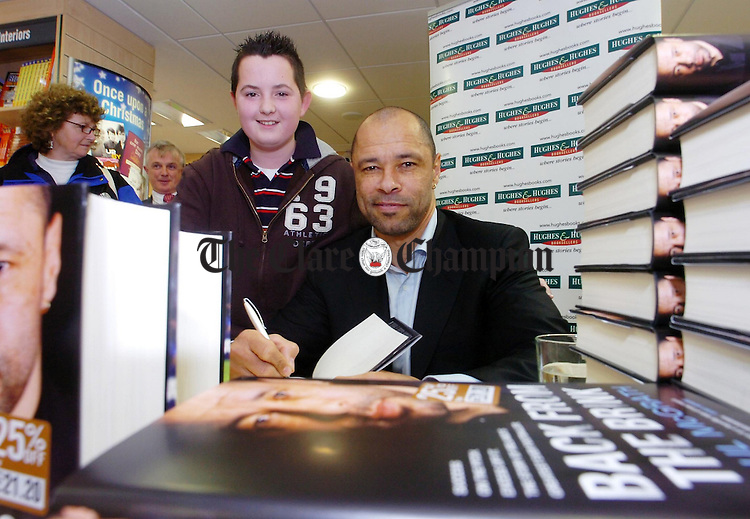 Football legend Paul McGrath meets 13 year old Dermot O'Donoghue,Kilfenora, during his Book signing in Hughes & Hughes Ennis.Pic Arthur Ellis.
