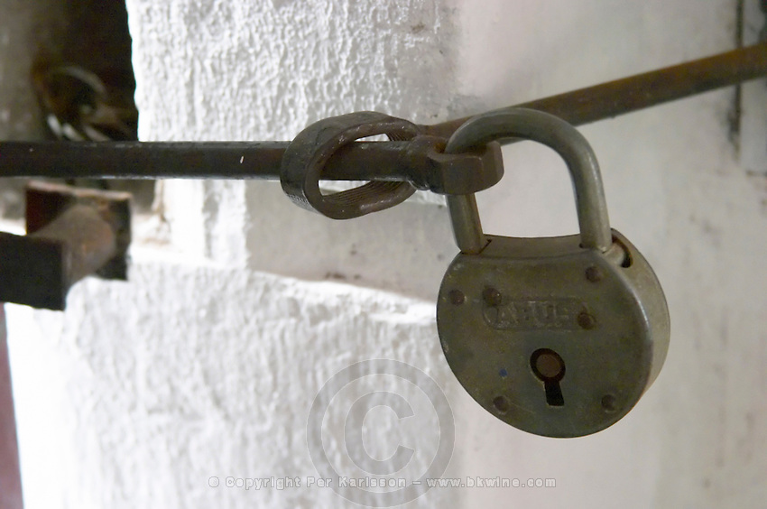 A big old ABUS padlock pad lock securing the door to the winery. Bodega Plaza Vidiella Winery, Las Brujas, Canelones, Uruguay, South America