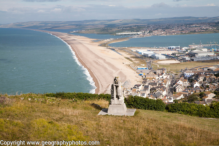 Chesil beach tombolo, with quarrying monument in the foreground  Chiswell, Isle of Portland, Dorset, England
