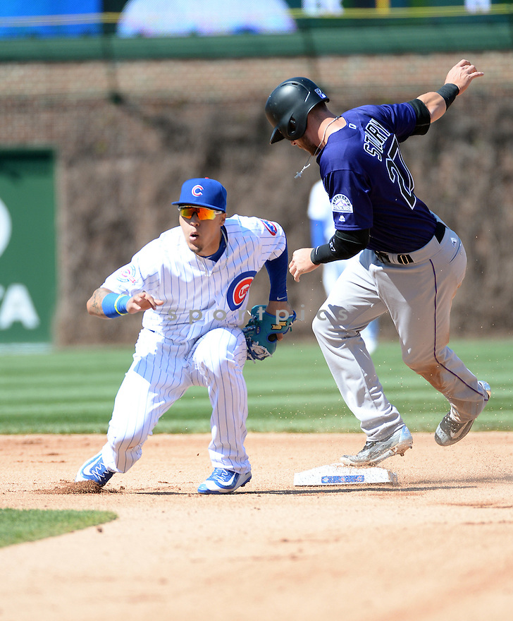 Chicago Cubs Javier Baez (9) during a game against the Colorado Rockies on April 17, 2016 at Wrigley Field in Chicago, IL. The Rockies beat the Cubs 2-0.
