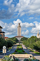 UT Tower Vertical 2 - This is the UT Tower taken from the south side with the Littlefield Fountain in view with nice puffy clouds and blue sky. The University of Texas towers is 307 feet tall and can be seen from many locations through out the city. It has become a part of the Austin cityscape. The UT Tower is a landmark for all as it can be seen from many locations throughout the city. Toursits and local have been comming to see this historical tower in downtown part of the city.