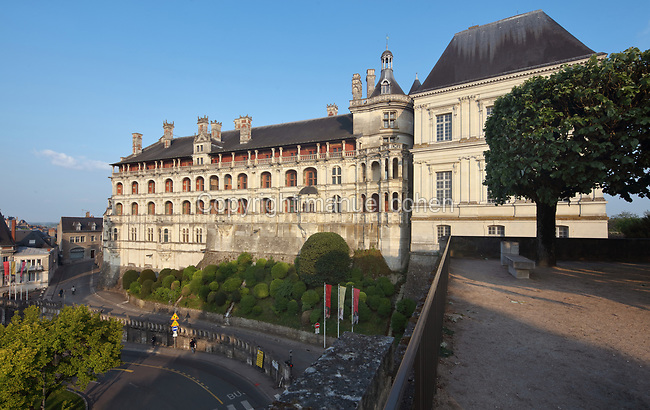 Rear facade of the Francois I wing overlooking Blois, built early 16th century in Italian Renaissance style, at the Chateau Royal de Blois, built 13th - 17th century in Blois in the Loire Valley, Loir-et-Cher, Centre, France. The chateau has 564 rooms and 75 staircases and is listed as a historic monument and UNESCO World Heritage Site. Picture by Manuel Cohen