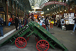 Interior of the old Covent Garden with green barrows in the foreground London England