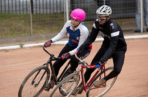 21 JUN 2015 - LONDON, GBR - Charlie-Jane Herbert (left) of Ipswich Eagles challenges Nick Gunkel (right) of East London for position at the first bend during their South East League Two cycle speedway fixture at Canning Town Recreation Ground in London, Great Britain (PHOTO COPYRIGHT © 2015 NIGEL FARROW, ALL RIGHTS RESERVED)
