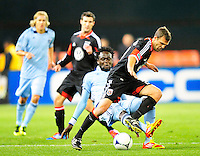 Kei Kamara of Sporting KC goes in for a slide tackle against United's Daniel Woolard.  Sporting Kansas City defeated D.C. United 1-0 during an MLS home opener at the RFK Stadium in Washington, D.C. on Saturday, March 10, 2012. Alan P. Santos/DC Sports Box