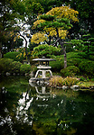 Japanese Zen garden with a lantern and a pond in Osaka Castle Park, beautiful tranquil autumn scenery. Osaka, Japan 2017