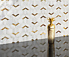 Boundary, a stone waterjet mosaic, show in polished Calacatta Gold and 24K gold, is part of the Miraflores Collection by Paul Schatz for New Ravenna.