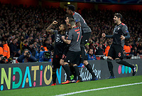 Robert Lewandowski of Bayern Munich (9) celebrates with his team mates after scoring from the penalty spot to make it 1-1- on the night during the UEFA Champions League round of 16 match between Arsenal and Bayern Munich at the Emirates Stadium, London, England on 7 March 2017. Photo by Alan  Stanford / PRiME Media Images.