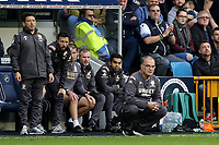 Leeds United Head Coach, Marcelo Bielsa and his coaching staff anxiously look on during Millwall vs Leeds United, Sky Bet EFL Championship Football at The Den on 5th October 2019