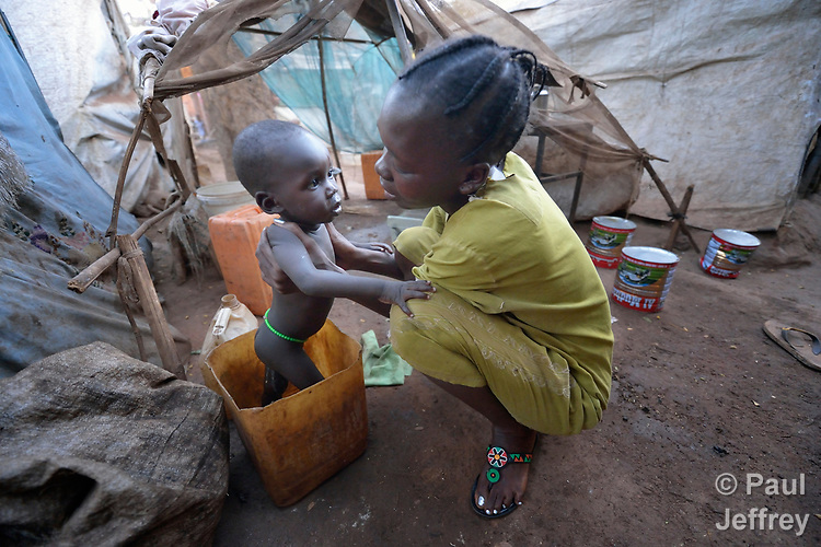 A mother and her child in a camp for more than 12,000 internally displaced persons located on the grounds of the Roman Catholic Cathedral of St. Mary in Wau, South Sudan. Most of the families here were displaced in June, 2016, when armed conflict engulfed Wau.<br /> <br /> Norwegian Church Aid, a member of the ACT Alliance, has provided relief supplies to the displaced in Wau, and has supported the South Sudan Council of Churches as it has struggled to mediate the conflict in Wau.