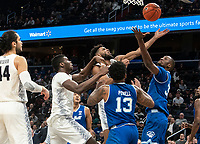 WASHINGTON, DC - FEBRUARY 05: Jagan Mosely #4 of Georgetown lifts up a shot over Romaro Gill #35 of Seton Hall during a game between Seton Hall and Georgetown at Capital One Arena on February 05, 2020 in Washington, DC.