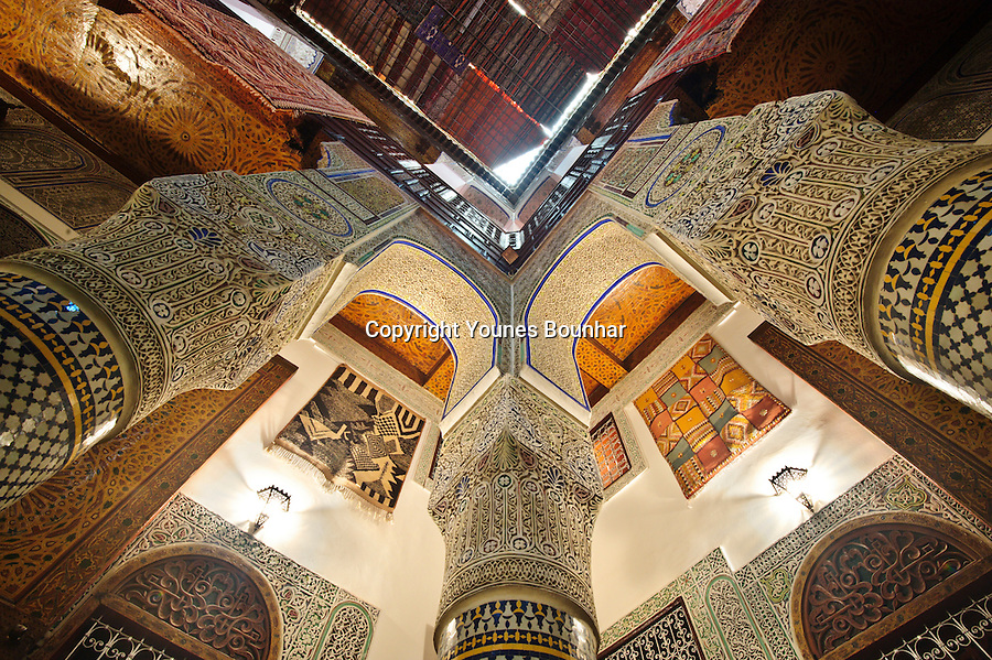 Beautiful and extravagant details of the intricate craftsmanship of an old moroccan riad (large house) of Fes