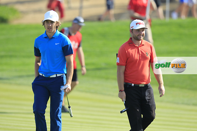 Tommy Fleetwood and Andy Sullivan (ENG) walk to the 1st green during Friday's Round 2 of the Abu Dhabi HSBC Golf Championship 2015 held at the Abu Dhabi Golf Course, United Arab Emirates. 16th January 2015.<br /> Picture: Eoin Clarke www.golffile.ie