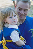 Father holds daughter in folk costume of Sweden. Svenskarnas Dag Swedish Heritage Day Minnehaha Park Minneapolis Minnesota USA